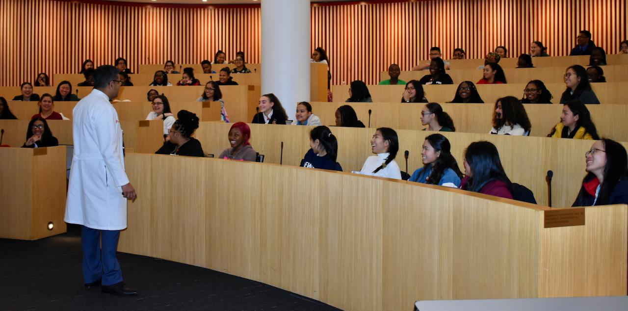 High school students listening to Weill Cornell physician speak in classroom during HPREP